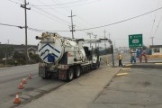 Waste Water truck pumping from street sewer access