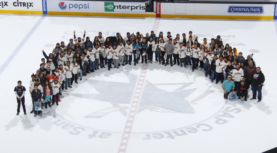 Teens from Saturday night teen program at center ice after San Jose Sharks game.